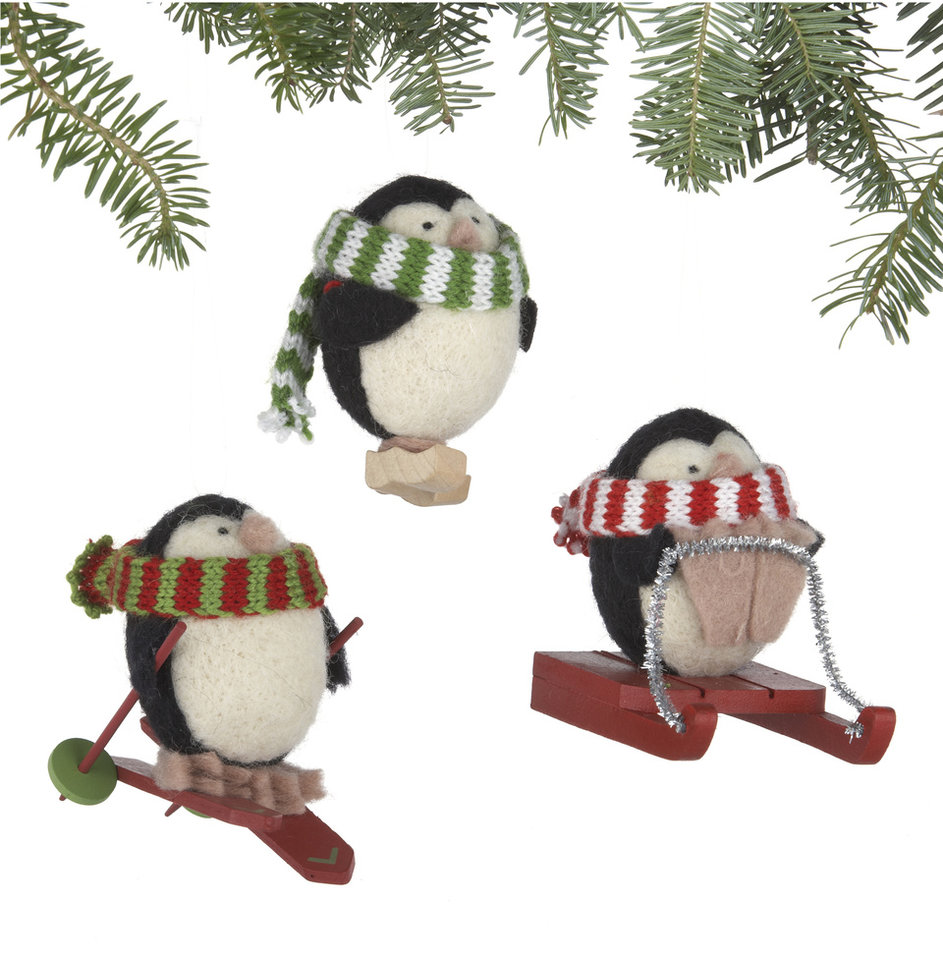 In this undated publicity image provided by Crate and Barrel, a set of three Alpaca Chubby Penguin ornaments made of soft alpaca blend wool by rural Peruvian women is shown. Crate and Barrel collaborated on the collection with a fair trade group that helps the women earn money to support and sustain their families. (AP Photo/Crate and Barrel)