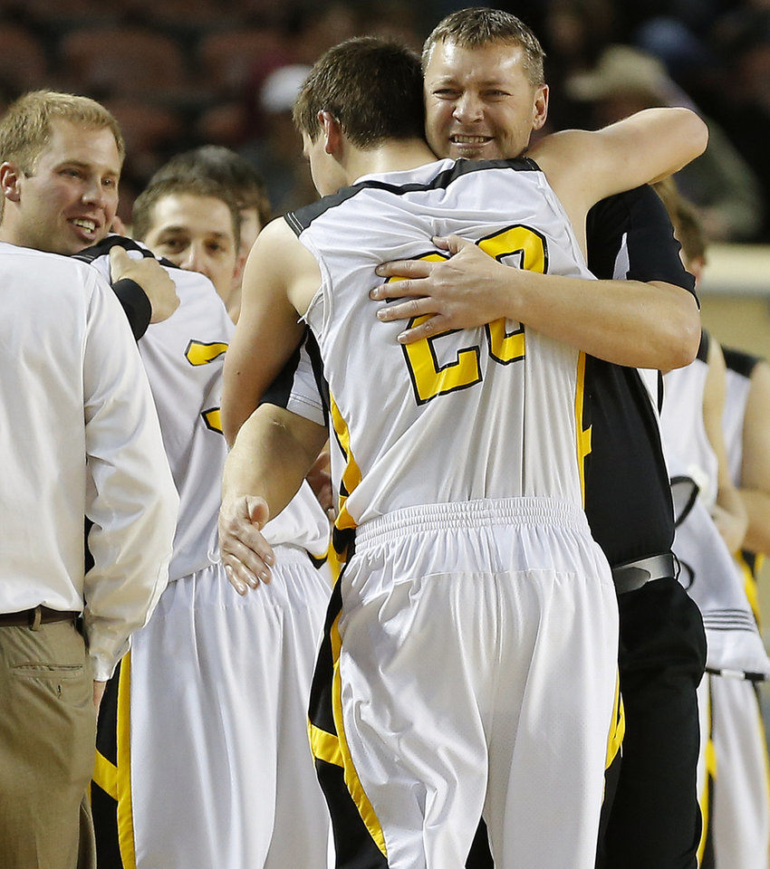 Arnett coach Allen Tune hugs his son Tyler Tune during the Class B boys state championship game between Coyle and Arnett in the State Fair Arena at State Fair Park in Oklahoma City, Saturday, March 2, 2013. Photo by Bryan Terry, The Oklahoman