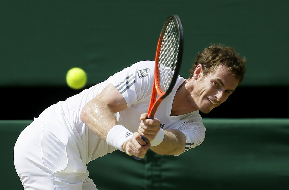 Photo - Andy Murray of Britain returns to Novak Djokovic of Serbia during the Men's singles final match at the All England Lawn Tennis Championships in Wimbledon, London, Sunday, July 7, 2013. (AP Photo/Alastair Grant)