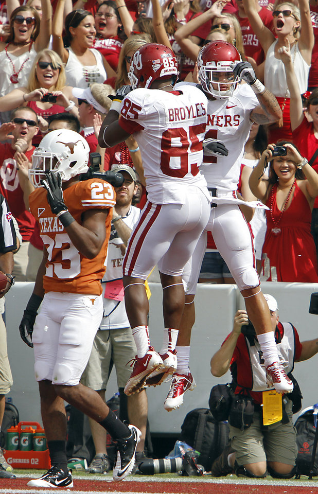 Photo - Oklahoma's Ryan Broyles (85) and Kenny Stills (4) celebrate a touchdown as Texas' Carrington Byndom (23) walks away during the Red River Rivalry college football game between the University of Oklahoma Sooners (OU) and the University of Texas Longhorns (UT) at the Cotton Bowl in Dallas, Saturday, Oct. 8, 2011. Photo by Chris Landsberger, The Oklahoman