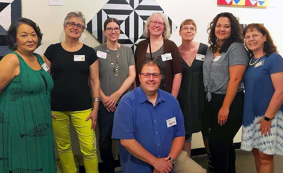 Photo - The members of the Qu'aint Collaboration - seven Oklahoma quilters and McAlester painter Jason Wilson - pose for a photo at Mainline Gallery in Tulsa. [Image provided]
