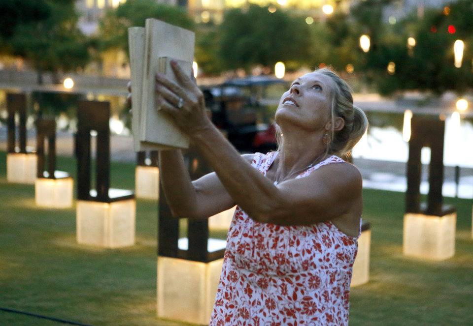 Debi Bays bangs boards together to try and scare migrating birds away from the Oklahoma City National Memorial in Oklahoma City, Tuesday, July 17, 2012. Photo by Bryan Terry, The Oklahoman