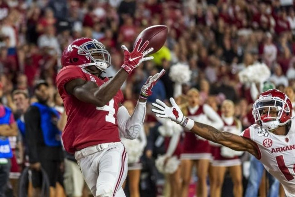 Photo -  Alabama receiver Jerry Jeudy (4) catches a touchdown pass against Arkansas on Oct. 26 in Tuscaloosa, Ala. [AP Photo/Vasha Hunt]