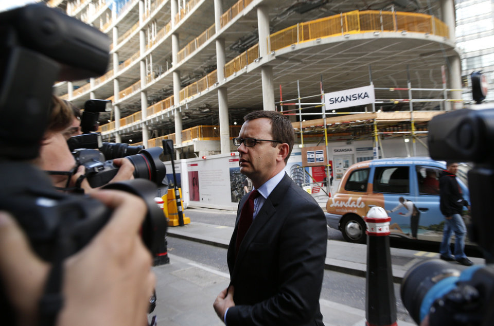 Photo - Andy Coulson, former News of the World editor, arrives at the Central Criminal Court in London, Wednesday, June 25, 2014. Coulson was convicted of phone hacking Tuesday, but fellow editor Rebekah Brooks was acquitted after a monthslong trial centering on illegal activity at the heart of Rupert Murdoch's newspaper empire. A jury at London's Old Bailey unanimously found Coulson, the former spin doctor of British Prime Minister David Cameron, guilty of conspiring to intercept communications. The nearly eight-month trial was triggered by revelations that for years the News of the World used illegal eavesdropping to get stories, listening in on the voicemails of celebrities, politicians and even crime victims. (AP Photo/Lefteris Pitarakis)