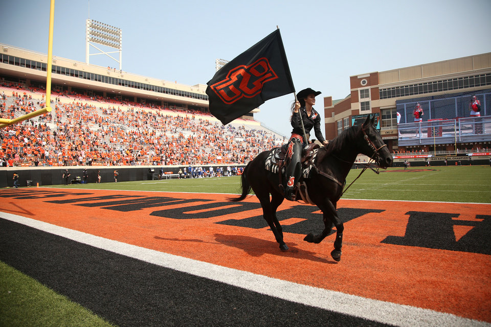 Photo - OSU student Harley Huff, of Evansville, Ind., guides Bullet across the field after the Cowboy's only touchdown during the second half of the Oklahoma State season opener against Tulsa at Boone Pickens Stadium in Stillwater on Saturday, September 19, 2020. Oklahoma State won the game 16-7.  JOHN CLANTON, TULSA WORLD