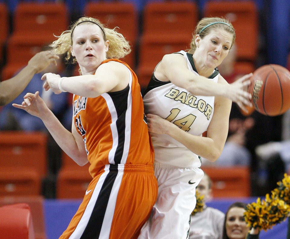 Photo - OSU's Megan Byford watches as Baylor's Rachel Allison passes the ball during the Big 12 Women's Championship game between Oklahoma State and Baylor at the Cox Center in Oklahoma City, Friday, March 13, 2009. OSU lost to Baylor 67-62.  PHOTO BY BRYAN TERRY, THE OKLAHOMAN