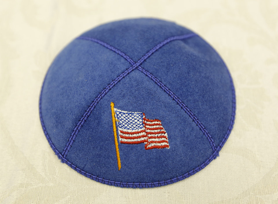 Photo -  A yarmulke emblazoned with an American flag, like the one shown, was sent to a Jewish Marine serving overseas as part of a Passover care package created by Sherri Jackson of Norman. A yarmulke, also known as a kippah, is a skull cap primarily worn by Jewish men. Photo By Steve Gooch, The Oklahoman   Steve Gooch -