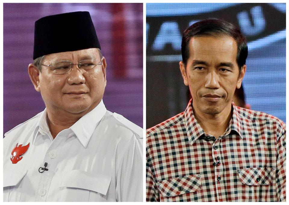 Photo - This combo of two photos, both taken on Saturday, July 5, 2014, shows Indonesian presidential candidates former special forces commander Prabowo Subianto, left, and Jakarta Governor Joko Widodo. Indonesia elects a new president on Wednesday with two clear choices: On the one side is the wildly popular former furniture maker and on the other is the ex-army general with a dubious record and once the son-in-law of former dictator Suharto. (AP Photo/Dita Alangkara)