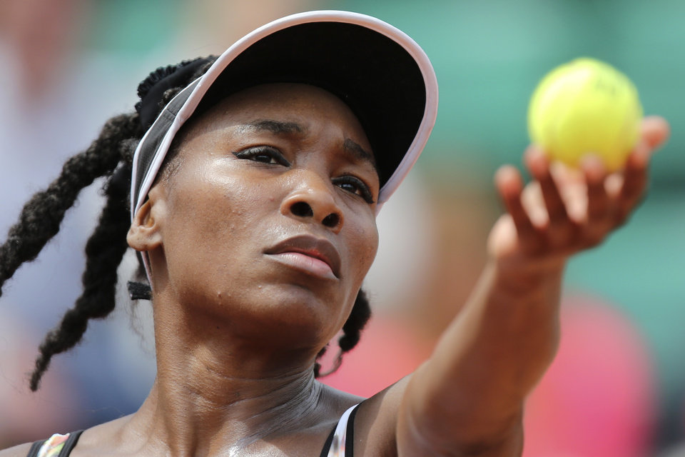 Photo - Venus Williams of the US serves the ball during the first round match of the French Open tennis tournament against Switzerland's Belinda Bencic at the Roland Garros stadium, in Paris, France, Sunday, May 25, 2014. (AP Photo/David Vincent)