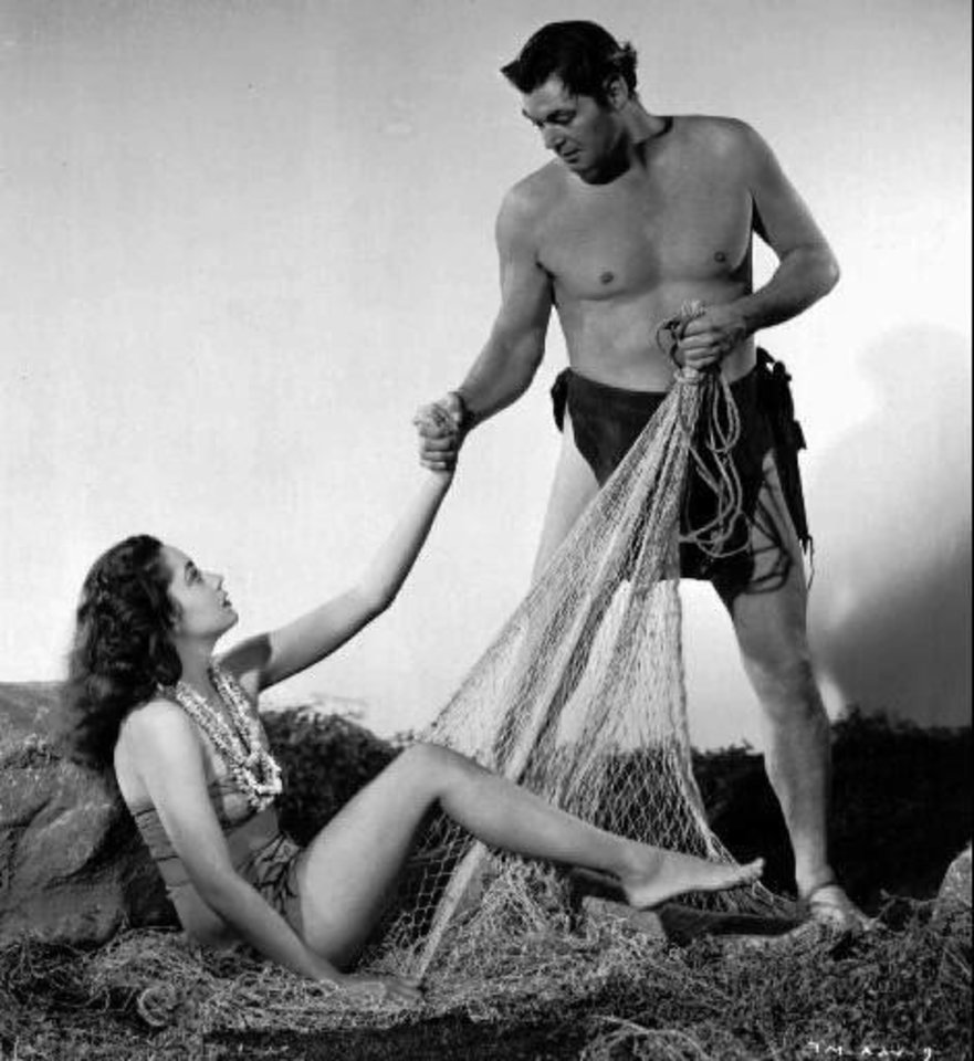 """A mermaid was the last thing Tarzan was fishing for, but his catch resulted in an exciting adventure in """"Tarzan And The Mermaids,"""" in 1948. Johnny Weissmuler starred as Tarzan. And Linda Christian was the leading mermaid.(AP photo/ho)"""