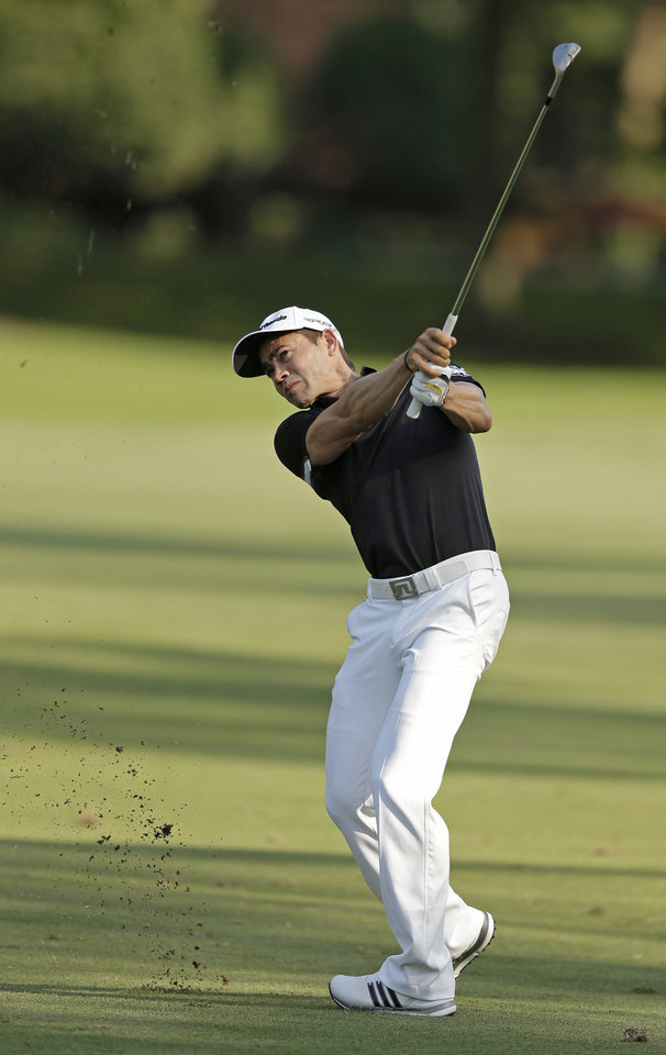 Photo - Camilo Villegas, of Colombia, hits his approach shot on the eighth hole during the first round of the Wyndham Championship golf tournament in Greensboro, N.C., Thursday, Aug. 14, 2014. (AP Photo/Chuck Burton)