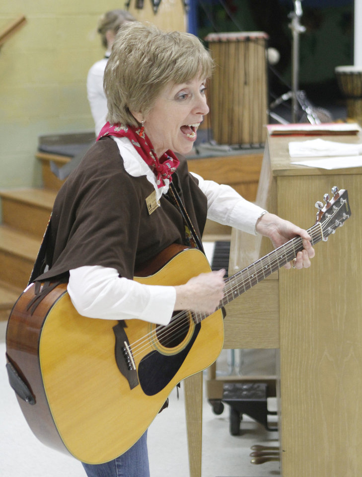 Chisholm Elementary School music teacher Missy Attebery plays a guitar during a hootenanny at the school in Edmond, OK, Friday, April 26, 2013,  By Paul Hellstern, The Oklahoman