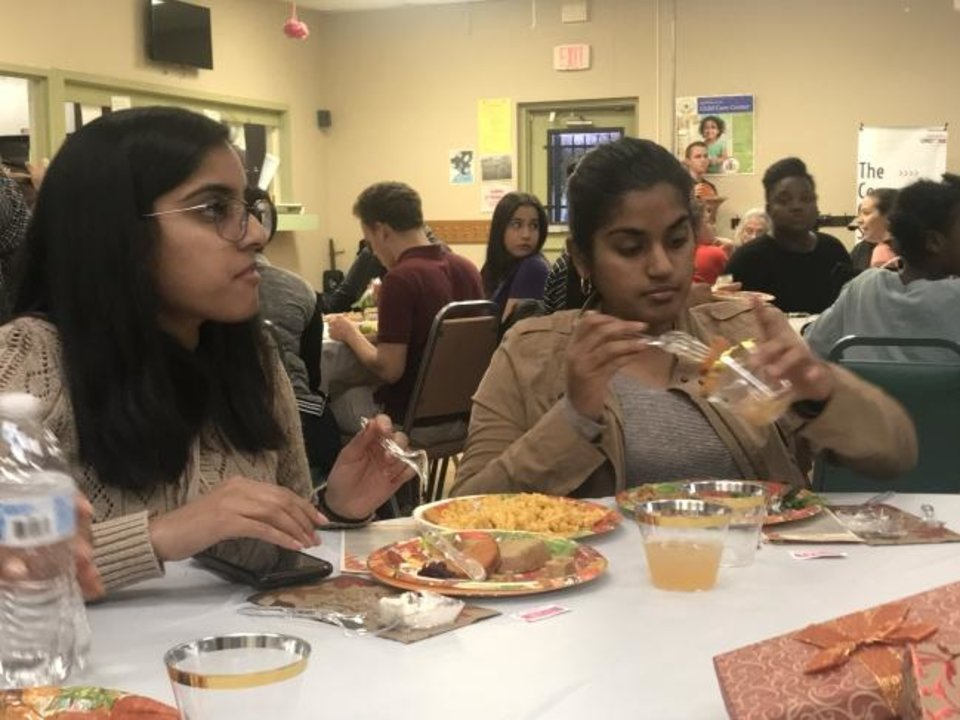 Photo -  Shivani and Krishna Gandhi of Moore eat at the Community Plant-based Thanksgiving Dinner hosted by A Table in the Wilderness. [Carla Hinton/The Oklahoman]