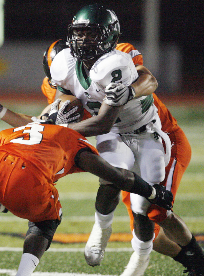 Photo - Tigers Kyle Carter (3) and Stephan McElroy (behind) combine to stop Emilio Gatewood as Norman High plays Norman North at Harve Collins Field on Friday Sept. 3, 2010, in Norman, Okla.  Photo by Steve Sisney, The Oklahoman