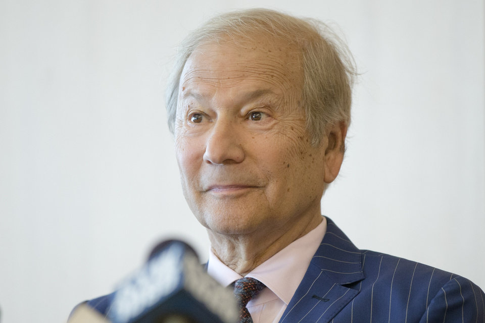 Photo - FILE - In this May 27, 2014 file photo, businessman Lewis Katz, left speaks at a news conference after a closed-door auction to buy the The Philadelphia Inquirer and Philadelphia Daily News in Philadelphia.  The editor of The Philadelphia Inquirer says co-owner Lewis Katz is among the seven people killed in a plane crash in Massachusetts.  Bill Marimow confirmed Katz's death to Philly.com on Sunday, June 1, 2014 saying he learned the news from close associates.  The plane crashed and caught fire as it was leaving Hanscom Field while on its way to Atlantic City International Airport. Massachusetts Port Authority spokesman Matthew Brelis says there were no survivors in the crash.   (AP Photo/Matt Rourke)