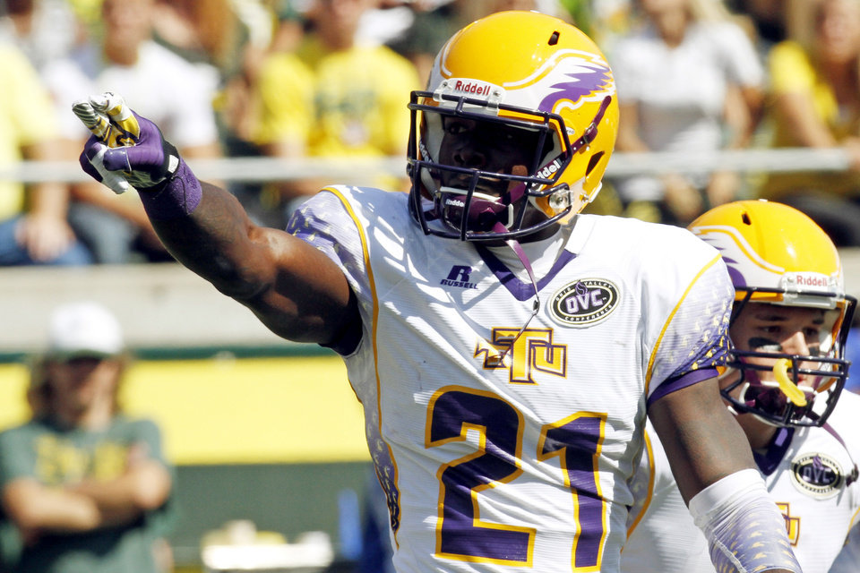 Photo -   Tennessee Tech receiver Da'Rick Rogers points to fans in the stands after scoring a touchdown during the first half of their NCAA college football game against Oregon in Eugene, Ore., Saturday, Sept. 15, 2012. (AP Photo/Don Ryan)