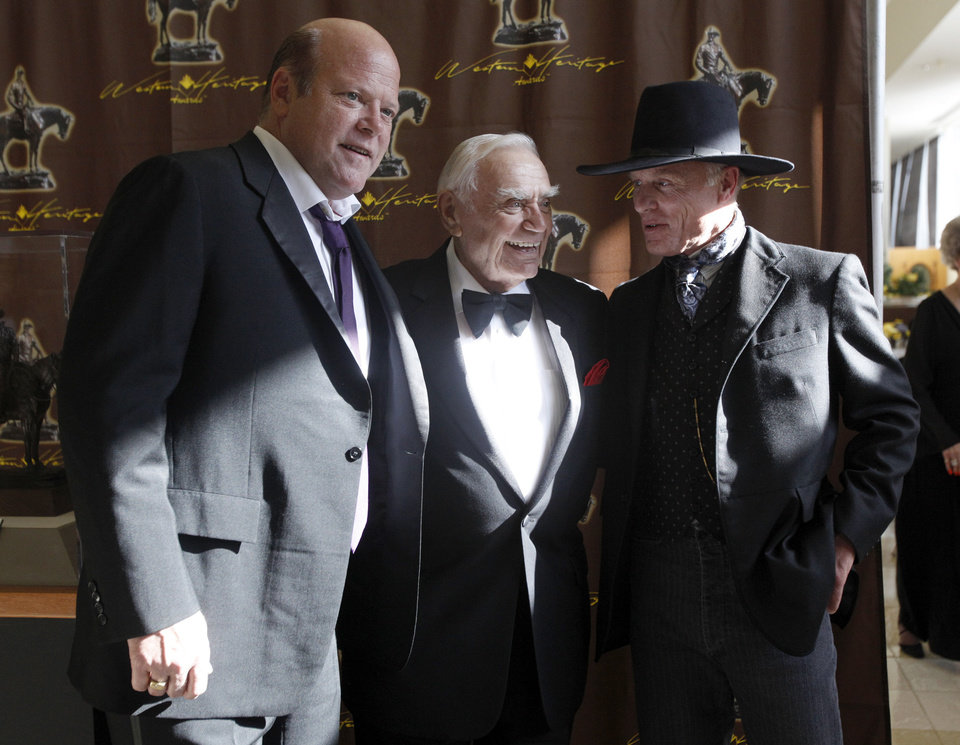 Photo - Rex Linn, Ernest Borgnine and Ed Harris take pictures before the 50th annual Western Heritage Awards, Saturday, April 16, 2011, at the National Cowboy & Western Heritage Museum in Oklahoma City. Photo by Sarah Phipps, The Oklahoman ORG XMIT: KOD