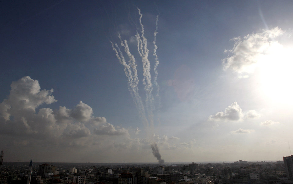 Photo -   Smoke trails are seen after ordnance were fired by Palestinian militants from Gaza City towards southern Israel, Monday, Nov. 19, 2012. (AP Photo/Hatem Moussa)