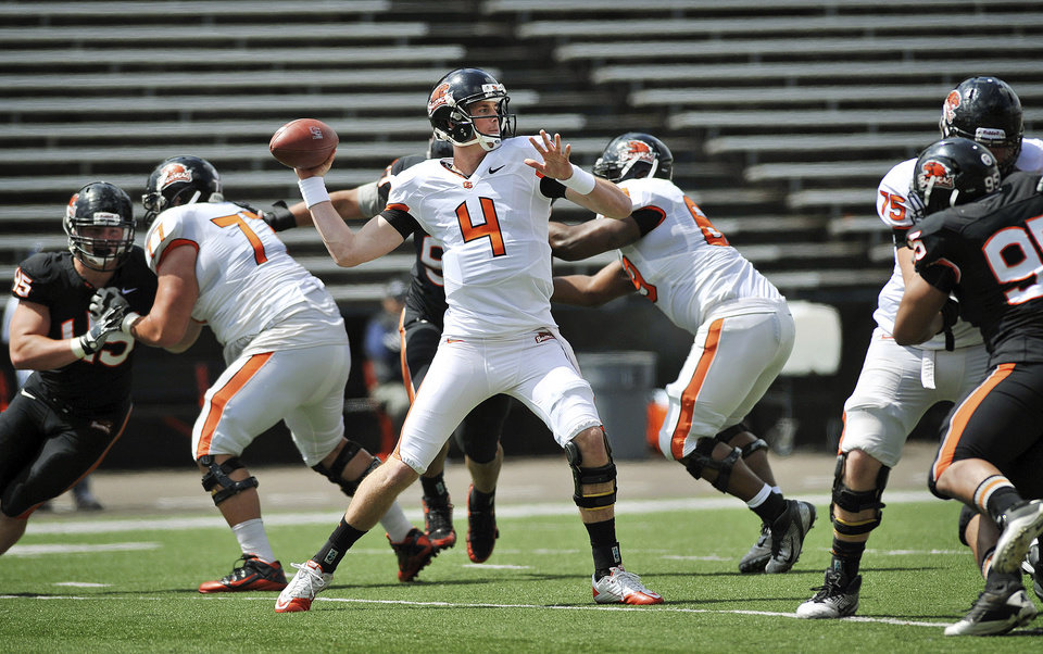 Photo -   Oregon State quarterback Sean Mannion throws a pass during their spring NCAA college football game, Saturday, April 28, 2012, in Corvallis, Ore. (AP Photo/The Corvallis Gazette-Times, Andy Cripe) MAGS OUT