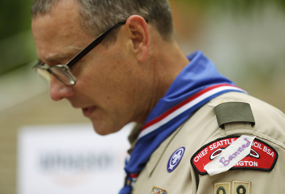 Photo - Geoffrey McGrath, a gay Boy Scout troop leader and Eagle Scout from Seattle, who had his membership in the Scouts revoked by the organization earlier this year, wears a piece of tape with the word