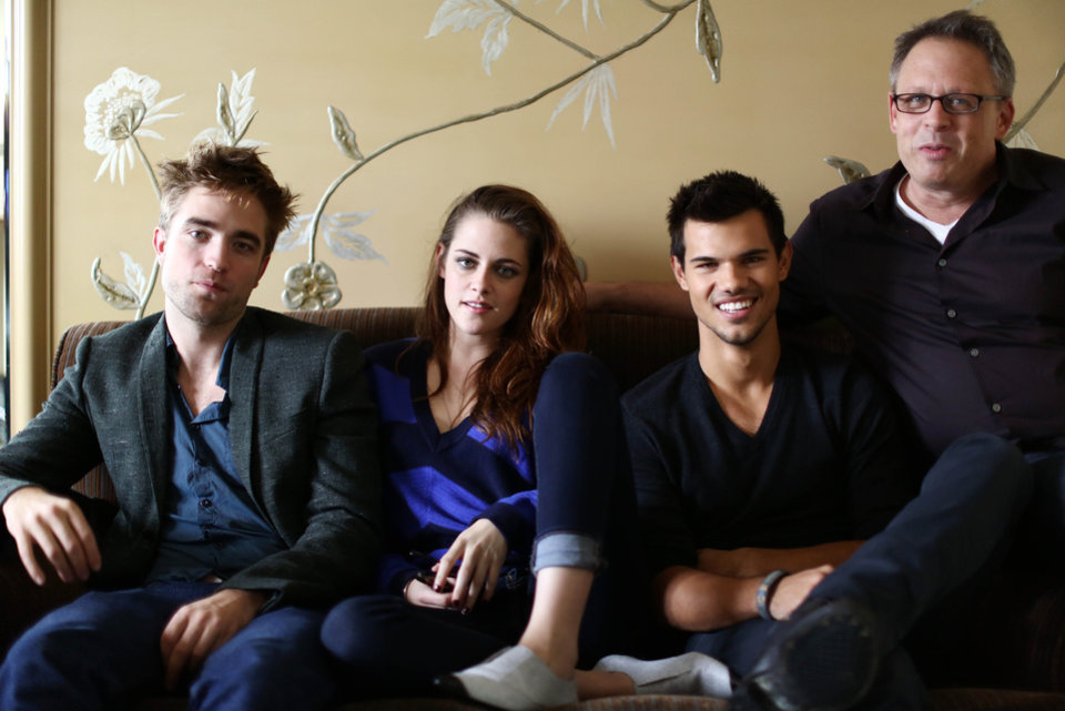 "In this Thursday, Nov. 1, 2012 photo, from left, actor Robert Pattinson, actress Kristen Stewart, actor Taylor Lautner, and director Bill Condon, from the upcoming film ""The Twilight Saga: Breaking Dawn Part 2,"" pose for a portrait in Los Angeles. ""Twilight"" rocketed Stewart and Pattinson to superstardom, and their real-life romance only propelled them further. With the release on Friday, Nov. 16, 2012 of the final film in the franchise, ""The Twilight Saga: Breaking Dawn Part 2,"" the young actors bid farewell to the worldwide fantasy sensation. (Photo by Matt Sayles/Invision/AP)"