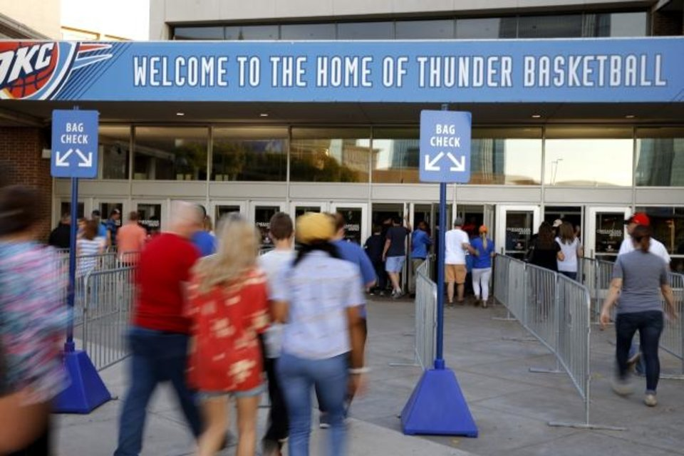 Photo -  Thunder fans enter Chesapeake Energy Arena before a preseason game on October 3. [Bryan Terry/The Oklahoman]