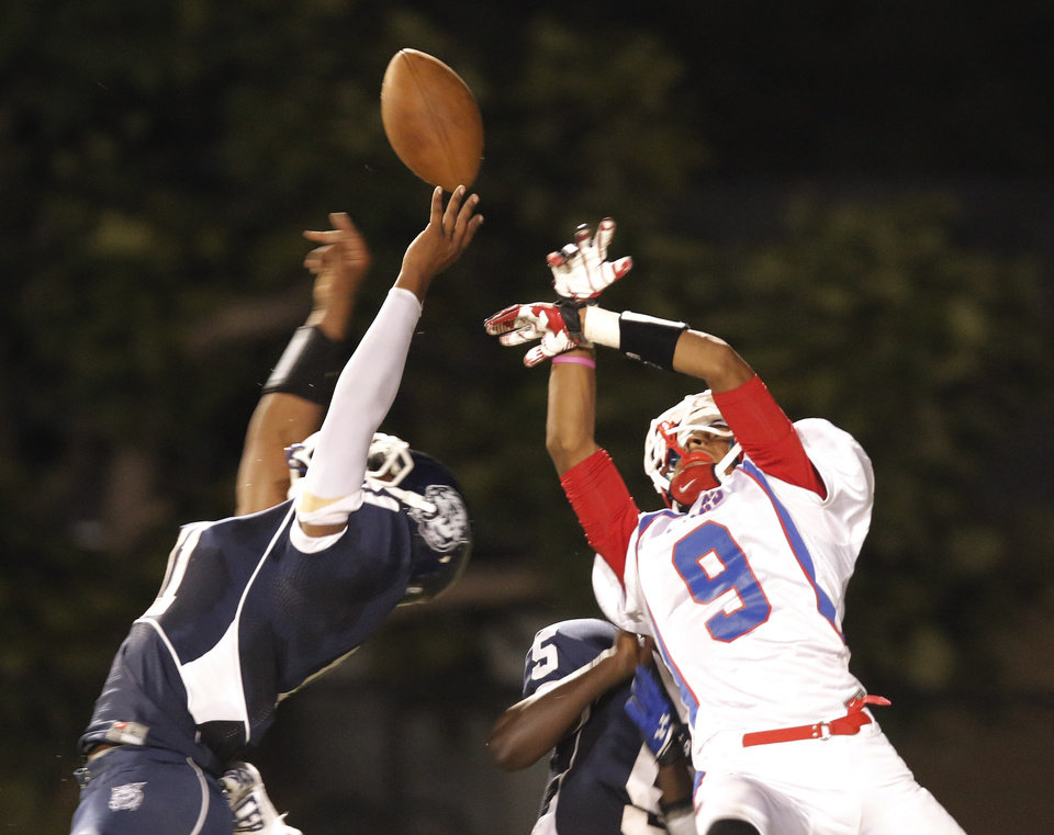 SS#11 Marshawn Reid II knocks away a pass intended for JM #9 Deonte Patterson during the high school football game of John Marshall at Star Spencer, Thursday, September 26, 2013. Photo by Doug Hoke, The Oklahoman