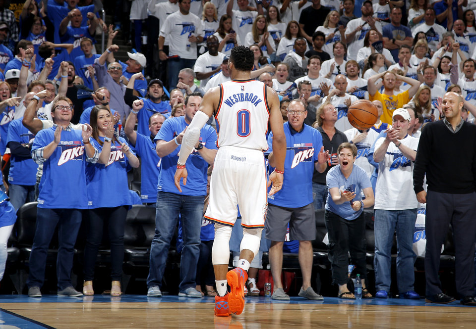 Photo - The crowd cheers for Oklahoma City's Russell Westbrook (0) during Game 3 of the Western Conference finals in the NBA playoffs between the Oklahoma City Thunder and the Golden State Warriors at Chesapeake Energy Arena in Oklahoma City, Sunday, May 22, 2016. Oklahoma City won 133-105. Photo by Bryan Terry, The Oklahoman