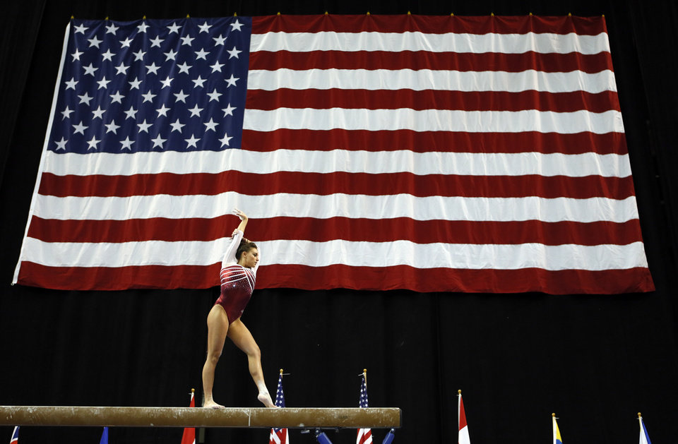 Oklahoma's Madison Mooring competes on the balance beam during the Perfect 10 Challenge women's collegiate gymnastics competition, part of the Bart and Nadia Sports Experience, at the Cox Convention Center in Oklahoma City, Friday, Feb. 21, 2014. Photo by Nate Billings, The Oklahoman