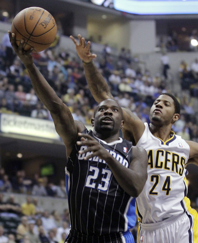 Photo -   Orlando Magic guard Jason Richardson, left, shoots in front of Indiana Pacers guard Paul George in the first half of Game 5 of an NBA basketball first-round playoff series, in Indianapolis on Tuesday, May 8, 2012. (AP Photo/Michael Conroy)