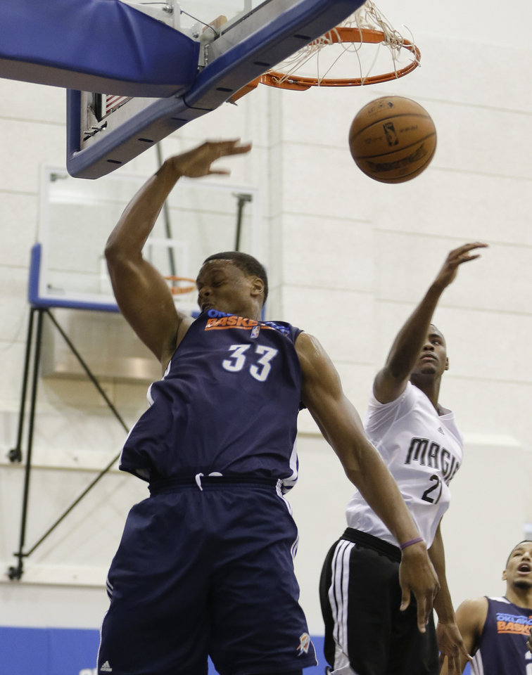 Oklahoma City Thunder's Daniel Orton (33) dunks the ball in front of Orlando Magic's Maurice Harkless during an NBA summer league basketball game, Monday, July 8, 2013, in Orlando, Fla. (AP Photo/John Raoux) ORG XMIT: DOA102