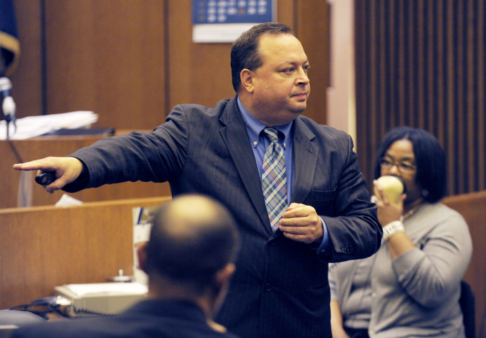 Photo - Asst. Prosecutor, Patrick Muscat presents closing arguments Wednesday, Aug. 6, 2014 in the Theodore Wafer case, in Detroit. The case of Waffen, a suburban Detroit homeowner who opened his front door and blasted an unarmed woman on his porch, has gone to the jury. Muscat urged jurors to convict Wafer of second-degree murder in the death of 19-year-old Renisha McBride. (AP Photo/Detroit News, Clarence Tabb Jr.)