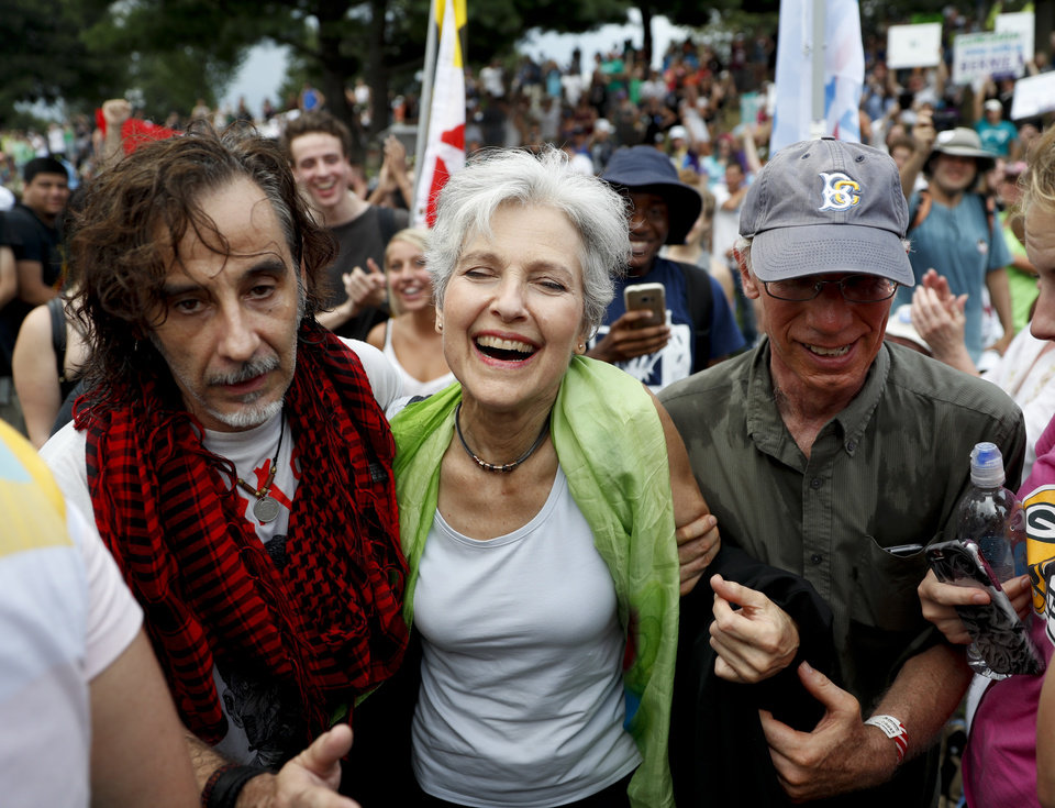 Photo - Dr. Jill Stein, presumptive Green Party presidential nominee, middle, arrives for a Power to the People Rally at Franklin Delano Roosevelt Park, Monday, July 25, 2016, in Philadelphia, during the first day of the Democratic National Convention. (AP Photo/John Minchillo)