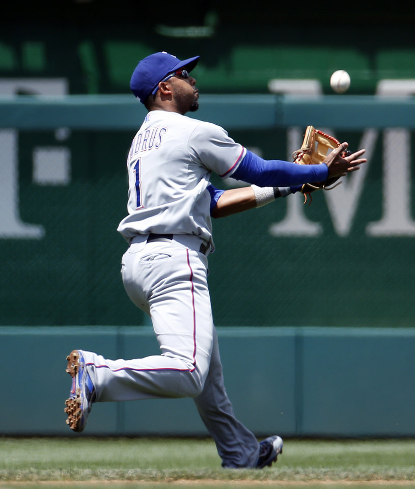 Photo - Texas Rangers shortstop Elvis Andrus (1) catches a ball hit by Washington Nationals' Jayson Werth during the first inning of a baseball game at Nationals Park, Sunday, June 1, 2014, in Washington. (AP Photo/Alex Brandon)