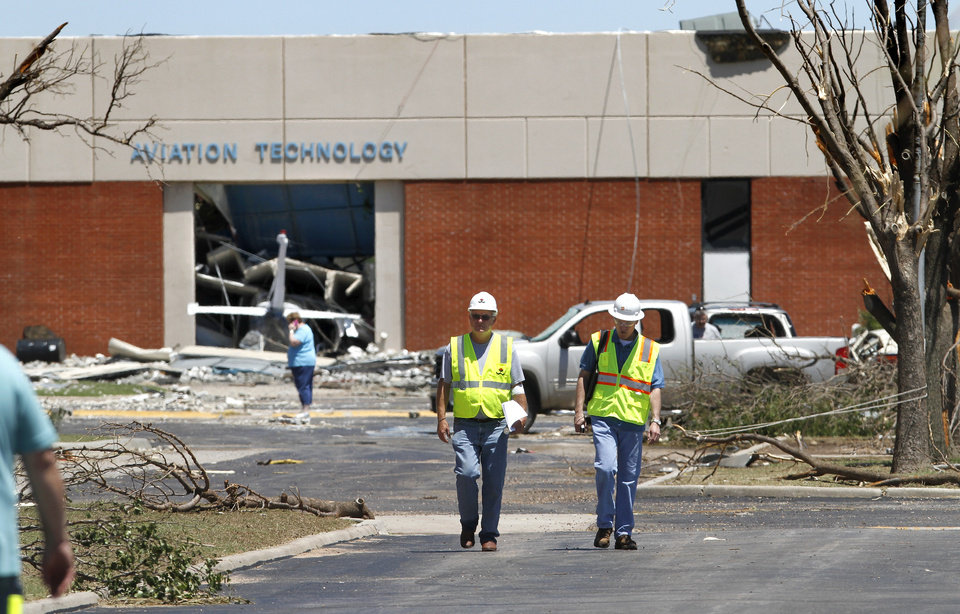 School officials walk past damaged buildings on the campus at Canadian Valley Technology Center  on Saturday, June 1, 2013. The facility was heavily damaged in last night's tornado in El Reno   Photo  by Jim Beckel, The Oklahoman.