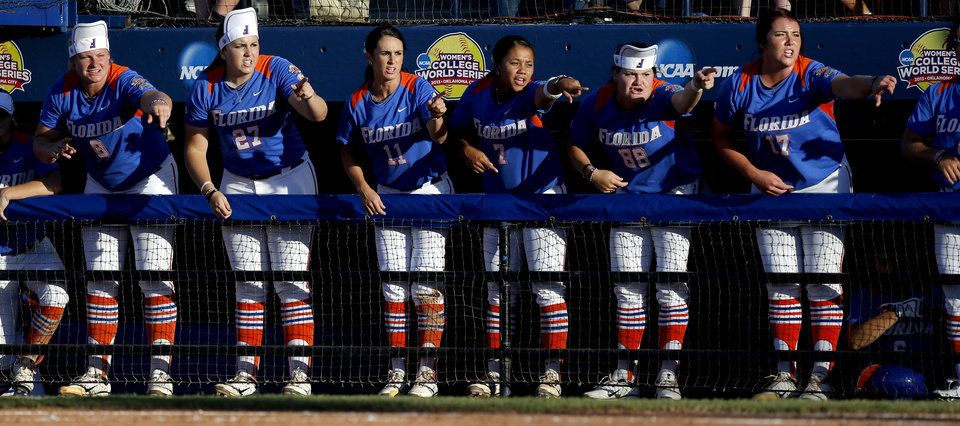 The Florida softball team chants during a Women's College World Series softball game between Nebraska and Florida at ASA Hall of Fame Stadium in Oklahoma City, Saturday, June, 1, 2013. Photo by Bryan Terry, The Oklahoman