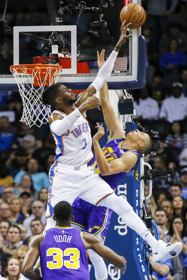 Photo - Oklahoma City's Nerlens Noel (3) blocks a shot by Utah's Dante Exum (11) during an NBA basketball game between the Utah Jazz and the Oklahoma City Thunder at Chesapeake Energy Arena in Oklahoma City, Monday, Dec. 10, 2018. Oklahoma City won 122-113. Photo by Nate Billings, The Oklahoman