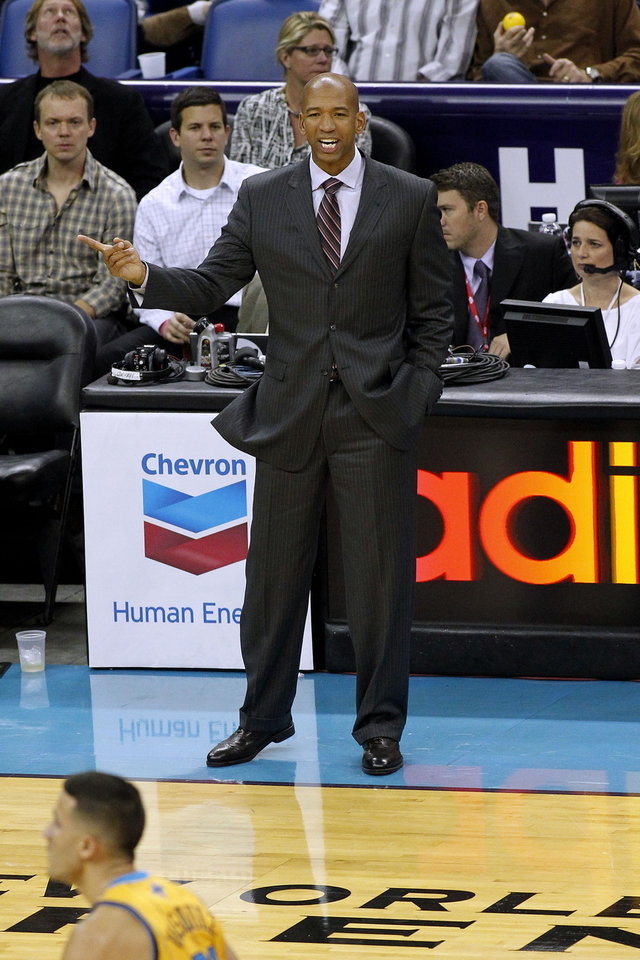 New Orleans Hornets head coach Monty Williams calls out to his team during the first half of an NBA basketball game in New Orleans, Friday, Nov. 16, 2012. The Thunder won 110-95. (AP Photo/Jonathan Bachman) ORG XMIT: LAJB111