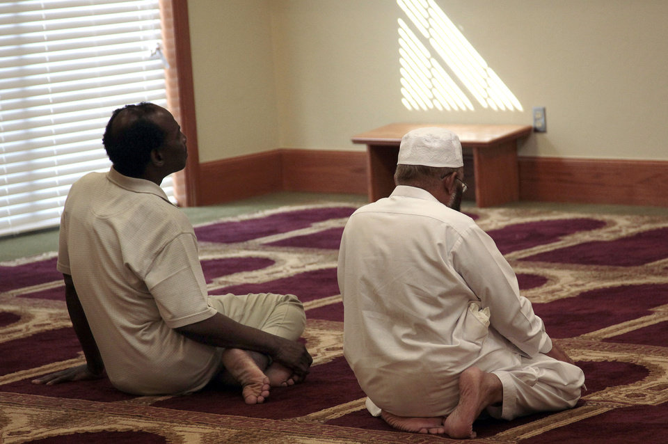 Photo - Men pray at the new mosque at 420 E Lindsey in Norman.  SARAH PHIPPS - SARAH PHIPPS