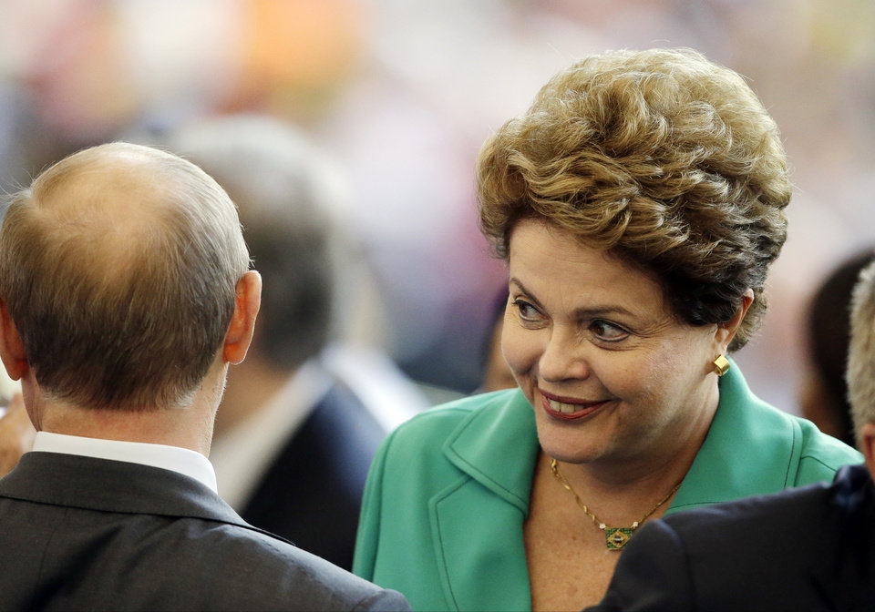 Photo - Brazil's President Dilma Rousseff speaks with Russian President Vladimir Putin during the World Cup final soccer match between Germany and Argentina at the Maracana Stadium in Rio de Janeiro, Brazil, Sunday, July 13, 2014. (AP Photo/Themba Hadebe)