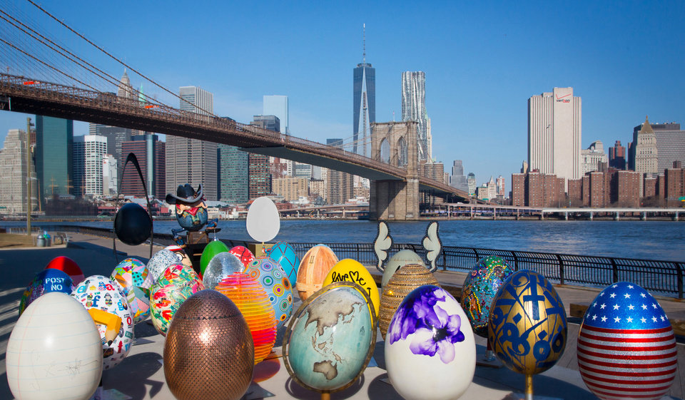 In this March 27, 2014 photo provided by HL Group, giant decorated egg sculptures are lined up in Brooklyn Bridge Park in the Brooklyn borough of New York. The eggs will be among the nearly 275 egg sculptures hidden around the city April 1 to April 17 as part of The Faberge Big Egg Hunt. The event is an old-fashioned Easter egg hunt with a 21st-century twist: The public will hunt for the eggs as part of an interactive contest using a smartphone app and participants will be eligible for prizes. (AP Photo/HL Group, Lyn Hughes Photography)