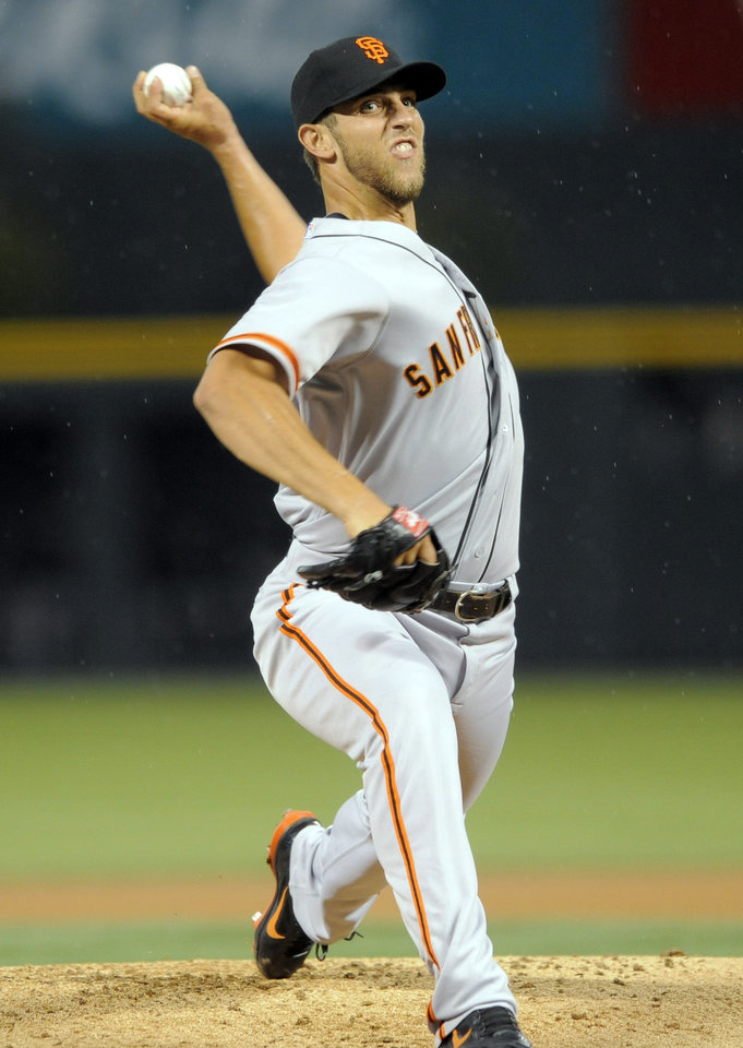 Photo -   San Francisco Giants starting pitcher Madison Bumgarner throws against the Colorado Rockies during the first inning of a baseball game Tuesday, Sept. 11, 2012, in Denver. (AP Photo/Jack Dempsey)