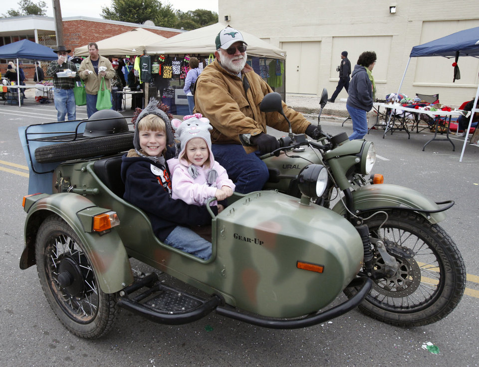 Jim Ethridge gives a motorcycle ride to 10 year old Cody Longley and his four year old sister Isabella during the Jones Old Timers Day celebration in Jones, OK, Saturday, October 6, 2012,  By Paul Hellstern, The Oklahoman
