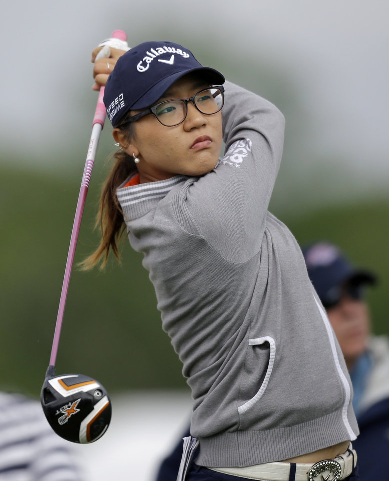 Photo - Lydia Ko, of New Zealand, watches her tee shot on the fourth hole during the first round of the ShopRite LPGA Classic golf tournament in Galloway Township, N.J., Friday, May 30, 2014. (AP Photo/Mel Evans)