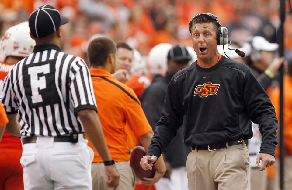 Photo - OSU's Mike Gundy argues a call during the college football game between the Oklahoma State Cowboys (OSU) and the Nebraska Huskers (NU) at Boone Pickens Stadium in Stillwater, Okla., Saturday, Oct. 23, 2010. Photo by Sarah Phipps, The Oklahoman