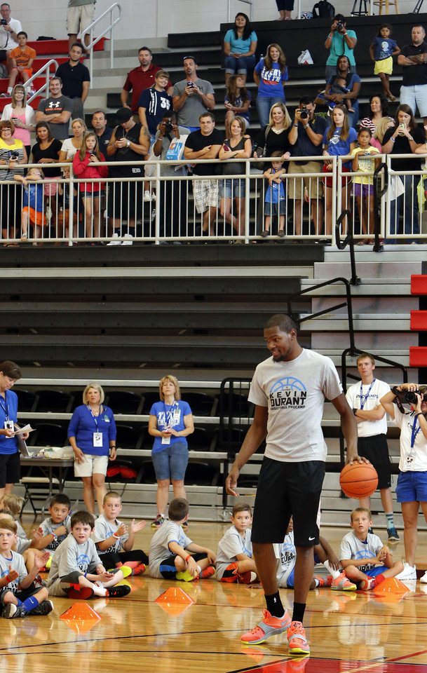 Photo - Kevin Durant talks to campers during his basketball camp on Thursday, Aug. 7, 2014 in Moore, Okla. Photo by Steve Sisney, The Oklahoman