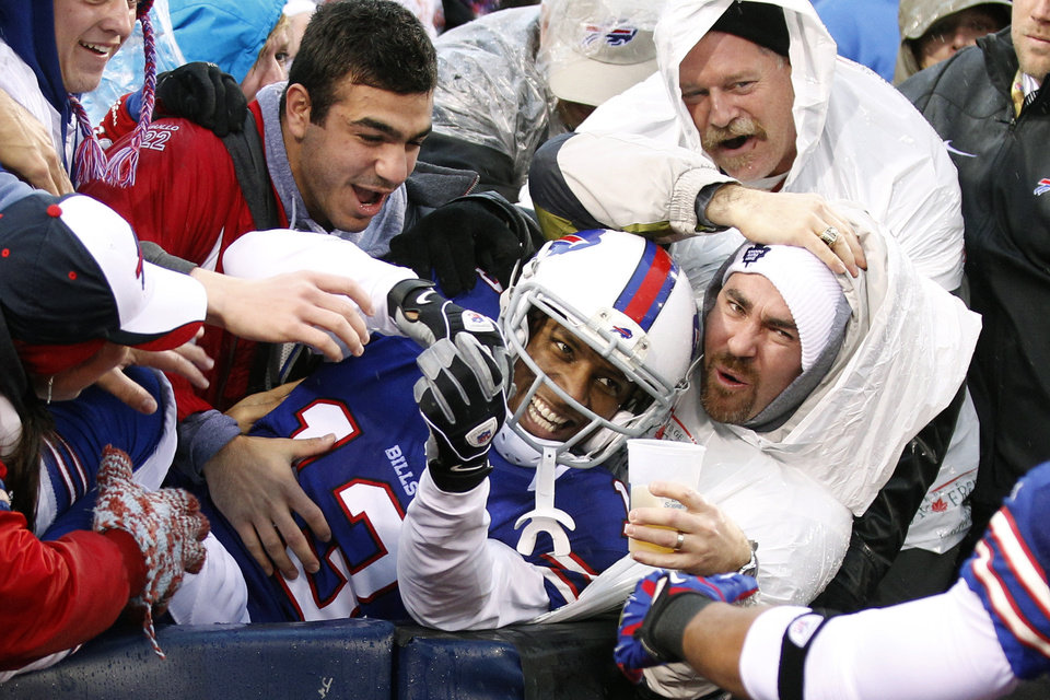 Photo - Buffalo Bills wide receiver Stevie Johnson (13) celebrates a touchdown catch with fans during the second half of an NFL football game against the Jacksonville Jaguars, Sunday, Dec. 2, 2012, in Orchard Park, N.Y. (AP Photo/Bill Wippert)