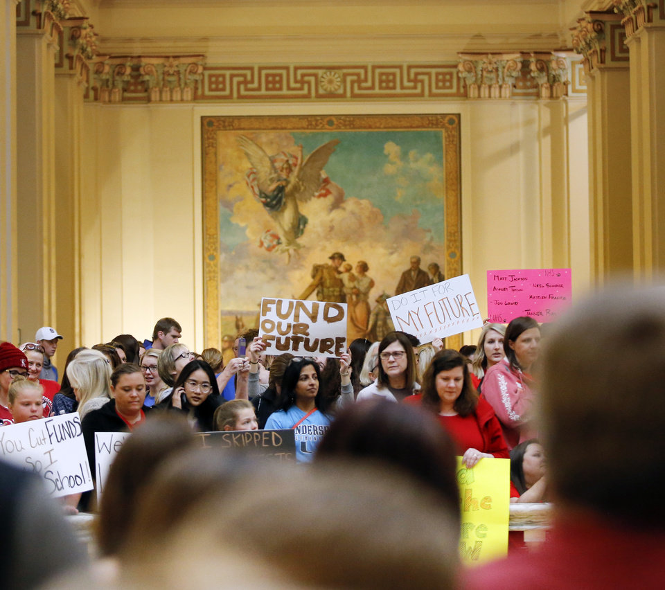 Photo - Teachers and supporters of increased education funding pack the fourth floor rotunda during the eighth day of a walkout by Oklahoma teachers at the state Capitol in Oklahoma City, Monday, April 9, 2018. Photo by Nate Billings, The Oklahoman