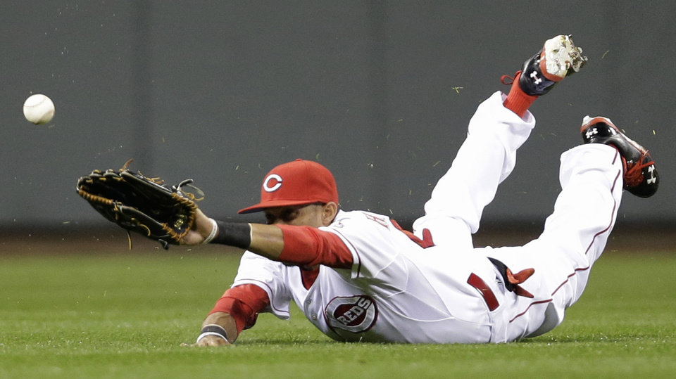 Photo - Cincinnati Reds center fielder Billy Hamilton can't reach a base hit by St. Louis Cardinals' Matt Carpenter in the fourth inning of a baseball game, Wednesday, April 2, 2014, in Cincinnati. (AP Photo/Al Behrman)
