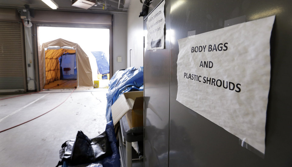 Photo - A tented area for decontaminating bodies is set-up just outside an intake area at the Snohomish County Medical Examiner's office, Wednesday, April 2, 2014, in Everett, Wash. The office is processing the remains of victims from the March 22 mudslide in nearby Oso, Wash., that has killed at least 29. Another 13 people are unaccounted for. (AP Photo/Elaine Thompson)